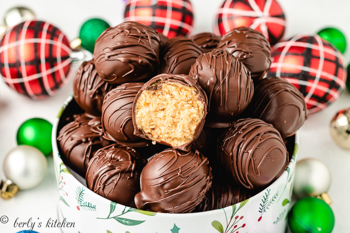 A peanut butter truffle with a bite removed to show the filling.