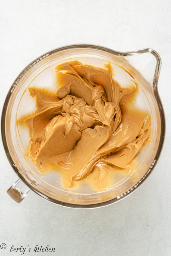 Unsalted butter and peanut butter combined in a mixing bowl.