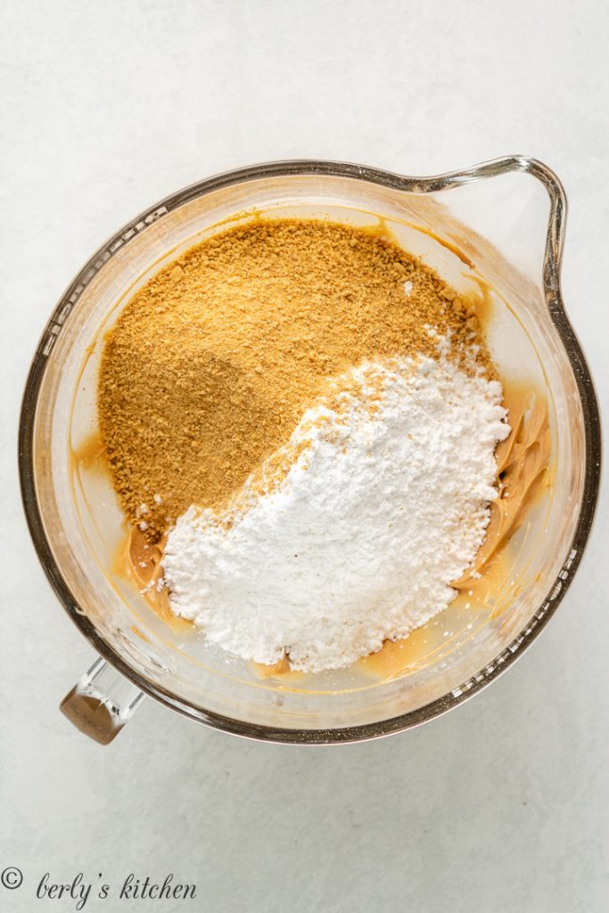 Powdered sugar and graham cracker crumbs added to the mixing bowl.