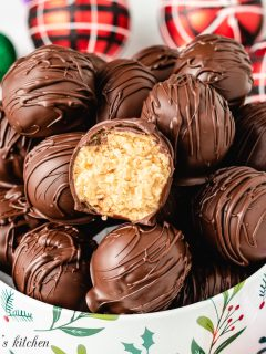 The chilled peanut butter balls in a decorative holiday tin.