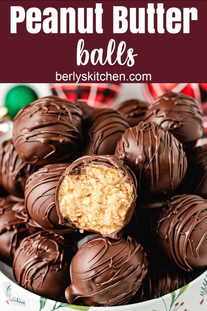 Peanut butter balls stacked in a holiday tin.