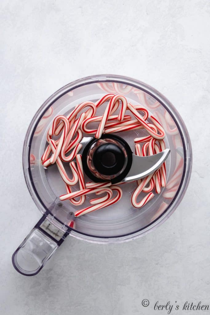 Mini candy canes in a food processor.