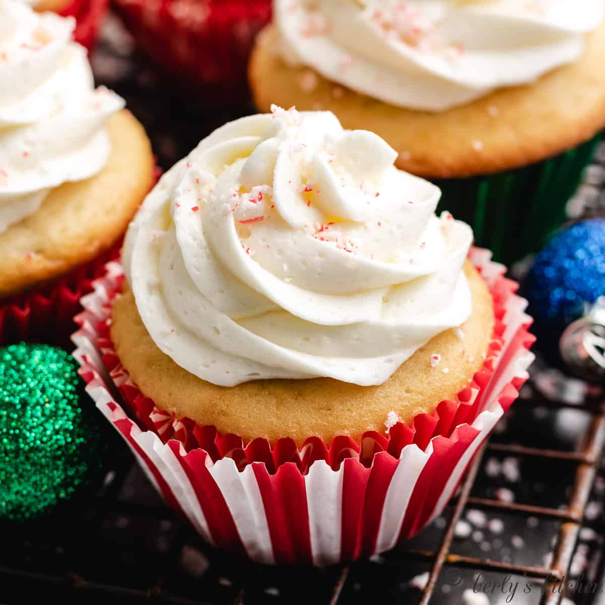 A cooled cupcake with peppermint frosting.