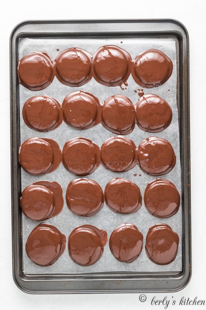 The peppermint patties topped with melted chocolate.