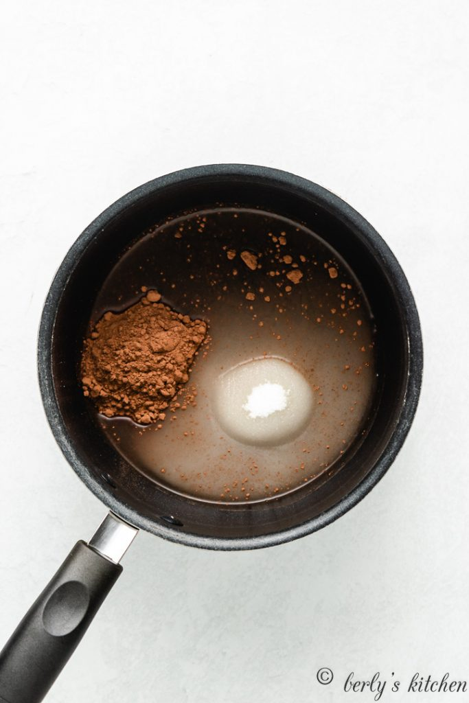 Cocoa powder, sugar, and water, in a saucepan.