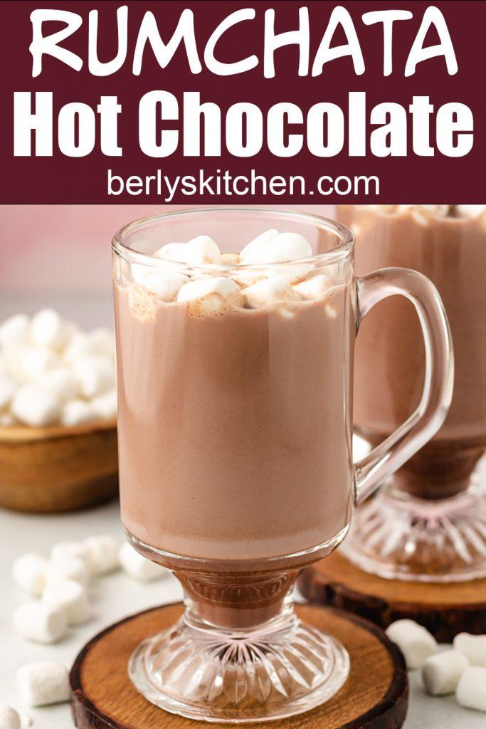 A rumchata hot chocolate served in a clear glass mug.
