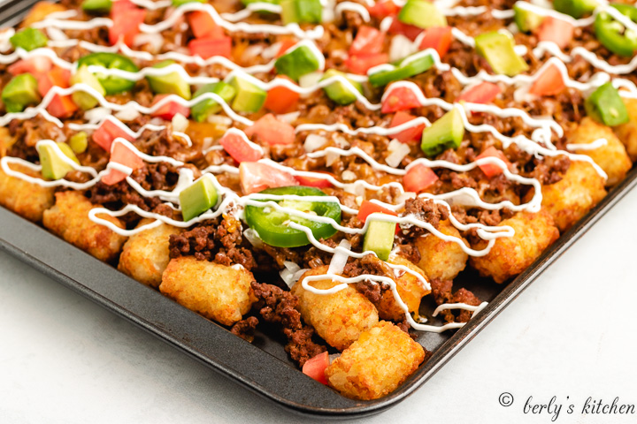 Loaded totchos on a sheet pan.