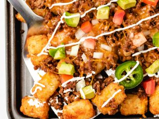 Tater tot nachos on a sheet pan.