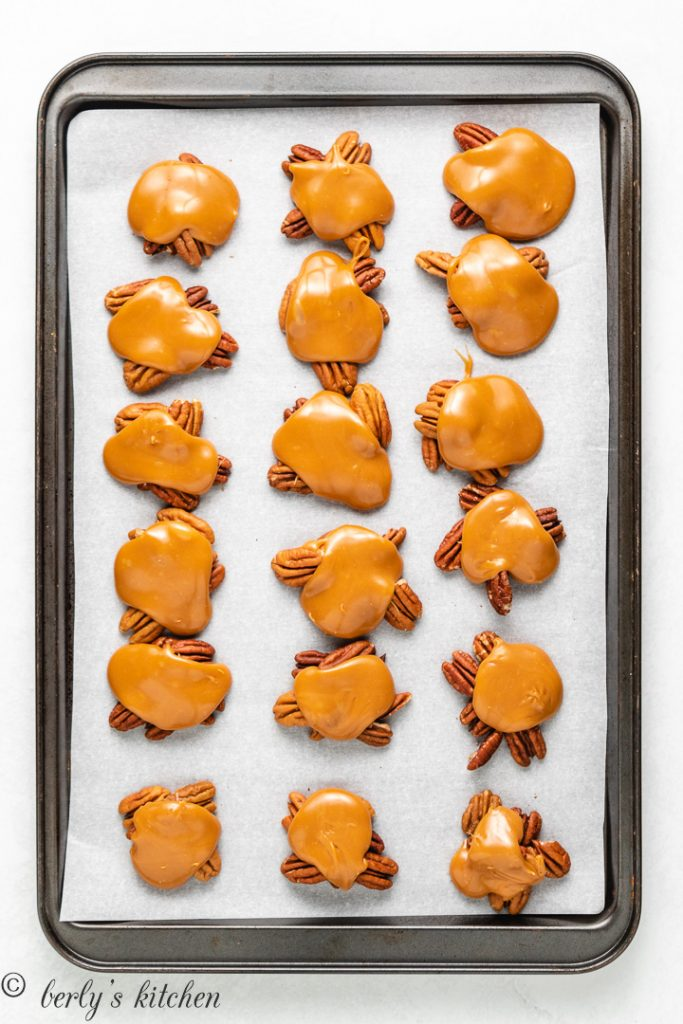 Melted caramel covering the pecan clusters.