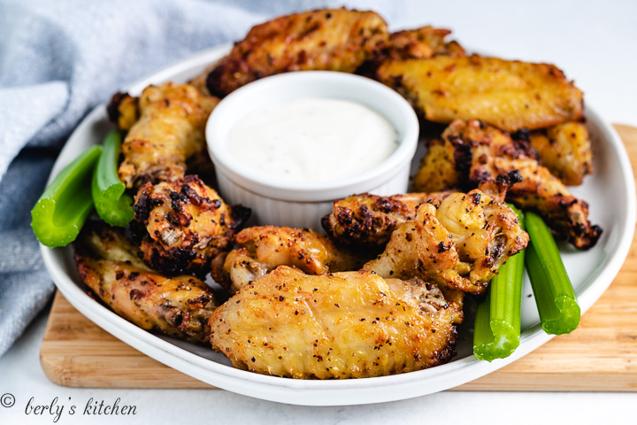 Air Fryer Lemon Pepper Wings on a plate with ranch dressing.