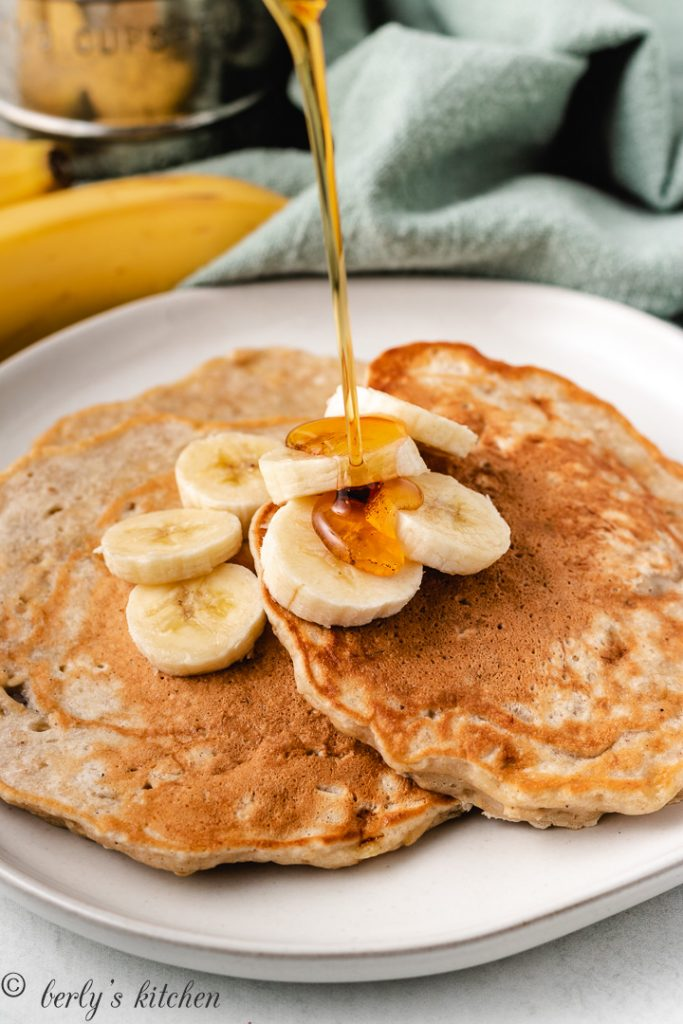Banana oat pancakes with syrup.