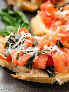 Easy tomato bruschetta with fresh basil.