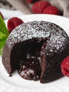 Molten lava cake with raspberries and mint.
