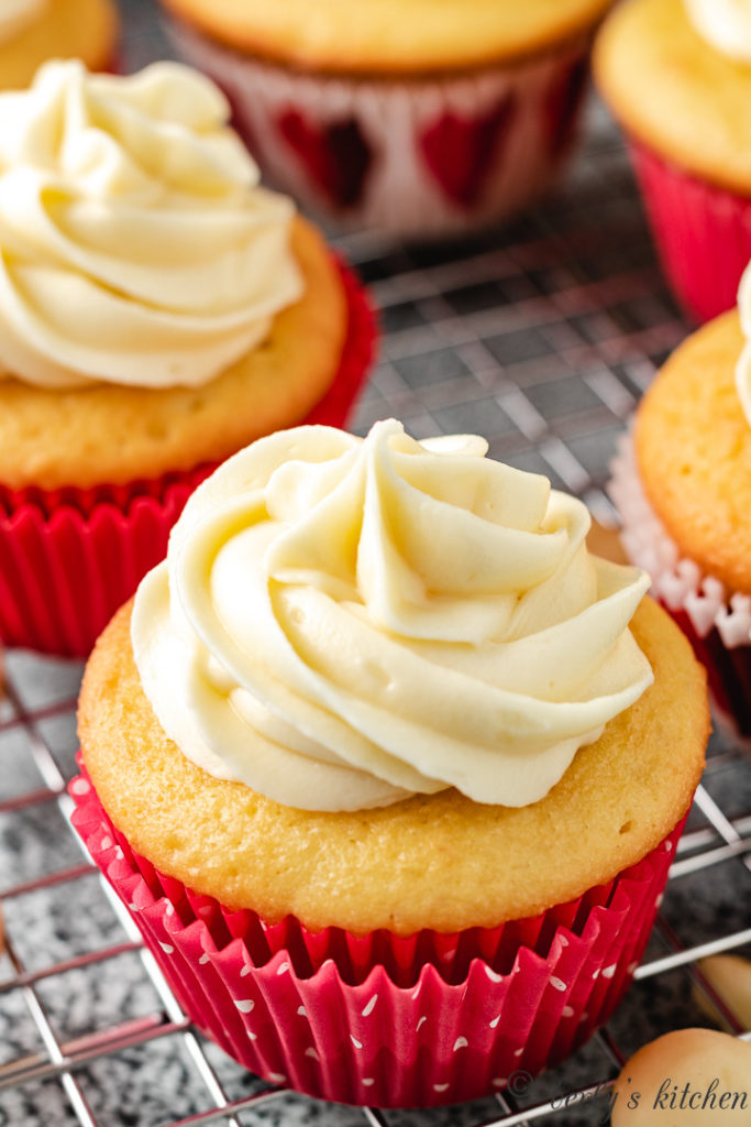 Yellow cupcake with macadamia flavor and white frosting.