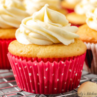 Yellow cupcakes in pink liners with white polka dots.