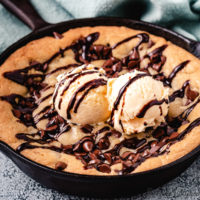 Mini Skillet Cookie with ice cream and chocolate syrup.