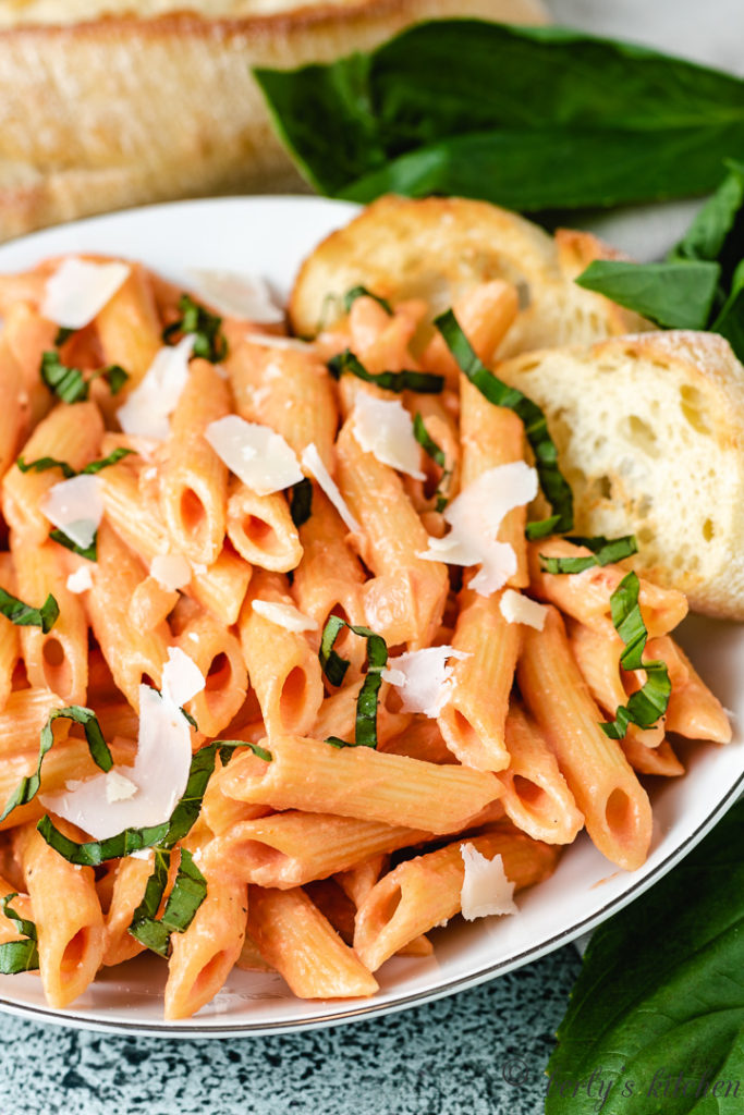 Penne noodles in pink sauce with fresh Parmesan.