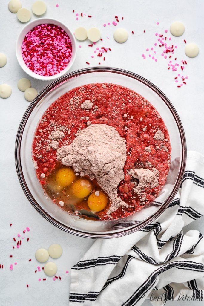Red velvet cake batter ingredients in a bowl.