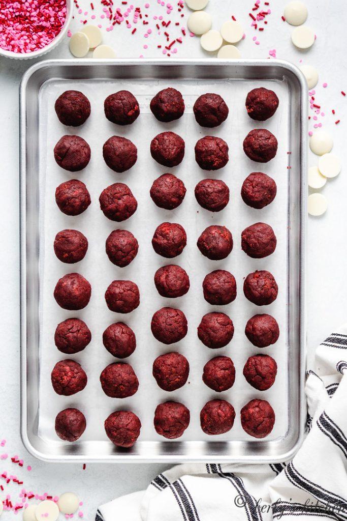 Cake balls on a pan.