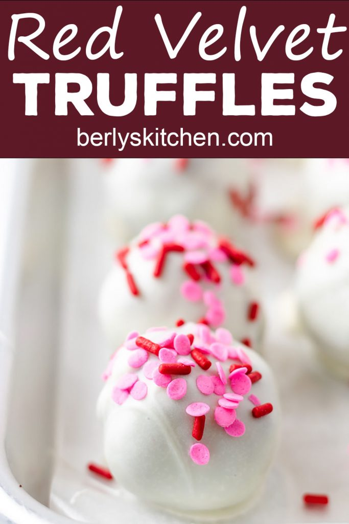 Valentine's Day truffles on a baking sheet.