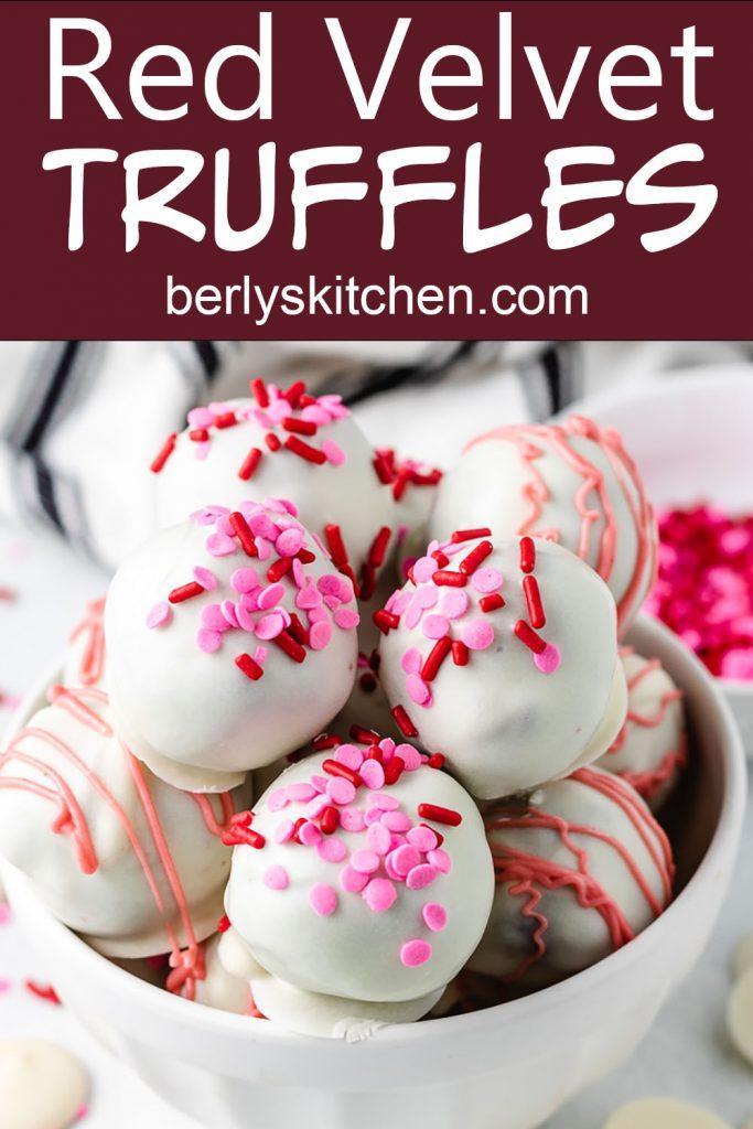 Several red velvet truffles with sprinkles.