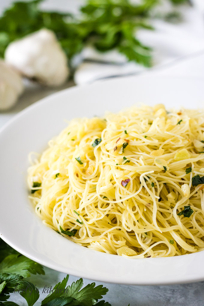 Angel hair pasta with red pepper flakes and parsely.