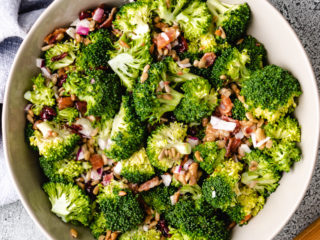 Top down view of broccoli salad in a gray serving dish.