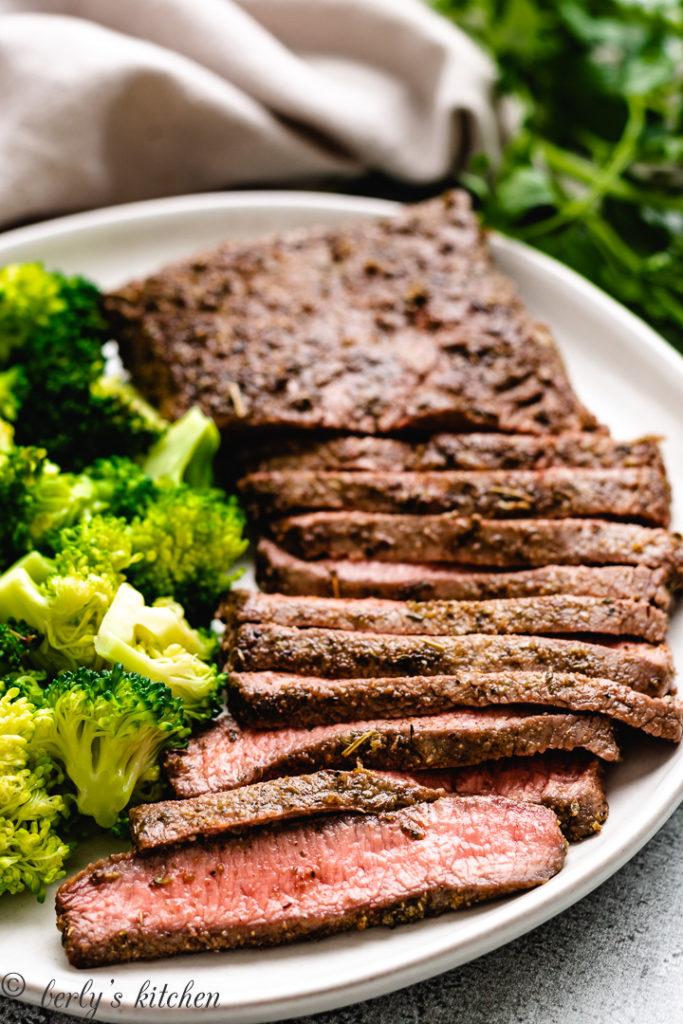 Sliced steak with fresh vegetables.
