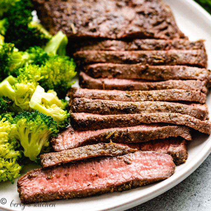 Flat iron steak and broccoli on a plate.