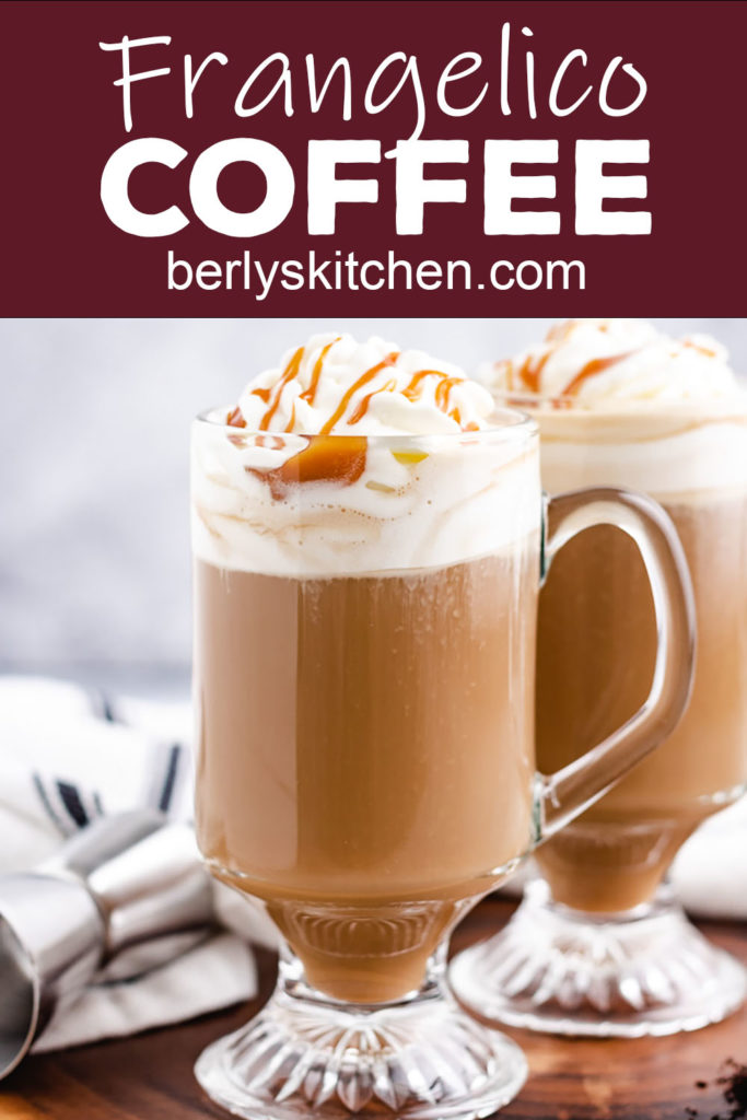 Two glass coffee mugs with hazelnut coffee and whipped cream.