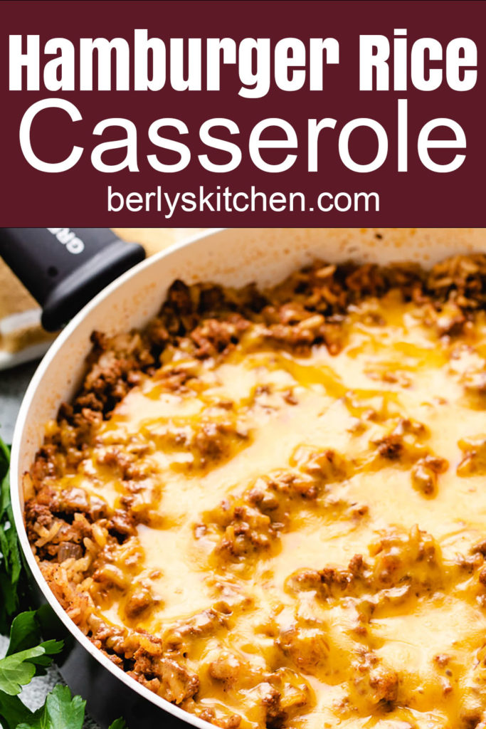 Pan of ground beef and rice casserole with cheddar cheese.