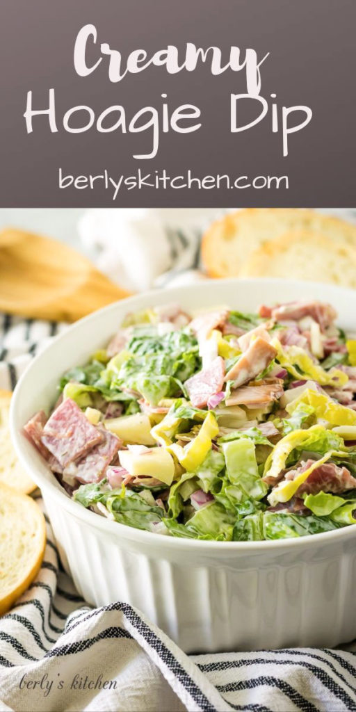 Large bowl of dip with lettuce and meat in a bowl.
