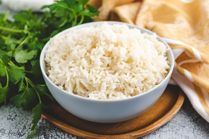 Bowl filled with cooked white rice.