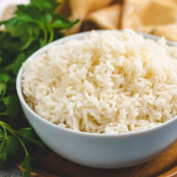 White rice in a blue bowl.