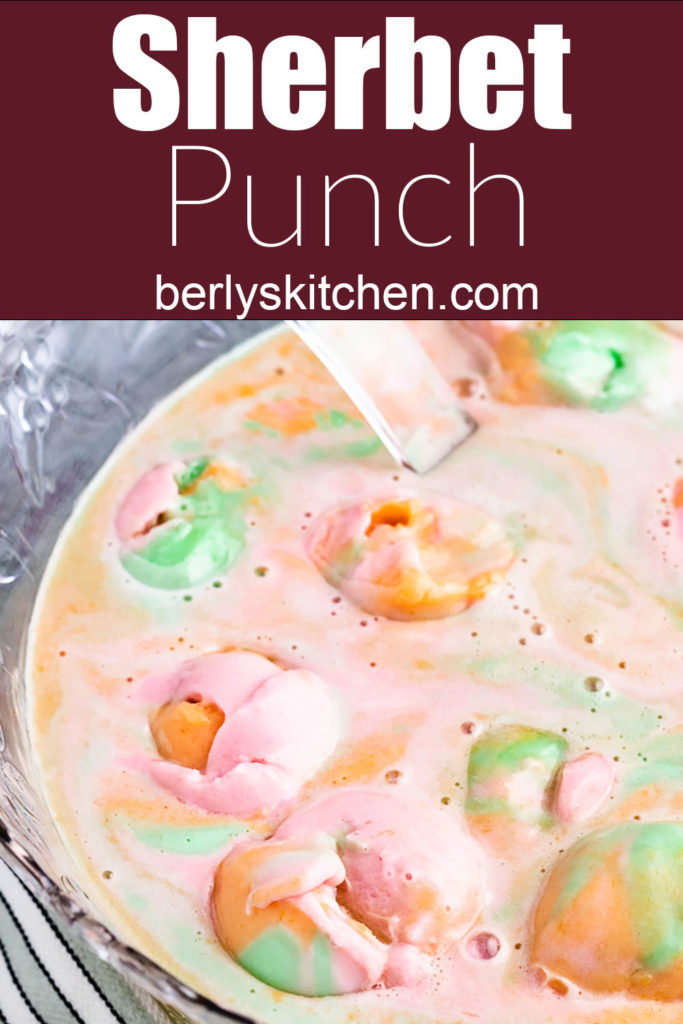 Top down view of rainbow sherbet punch in a large punch bowl.