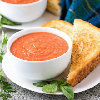 The tomato basil soup served with a grilled cheese sandwich.