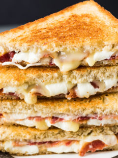 Two bacon grilled cheese sandwiches but in half.