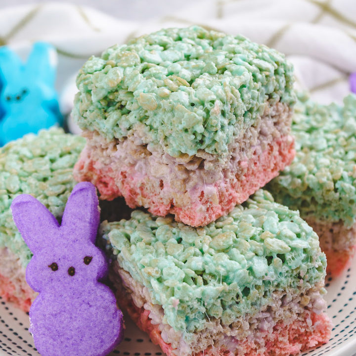 Pile of Easter rice krispie treats on a white dish.