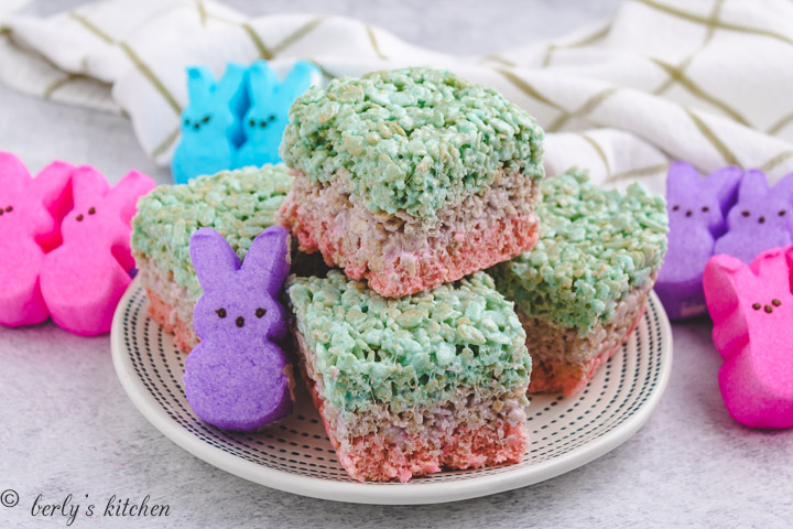 Layered Easter rice krispie treats on a white plate.