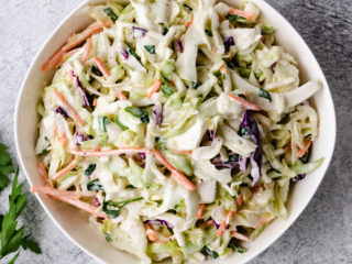 Top down view of cabbage slaw in a bowl.