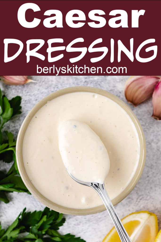 Homemade Caesar dressing on a spoon.