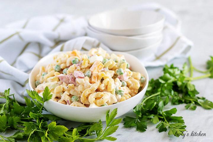 A big bowl of macaroni salad with a mayo based dressing.