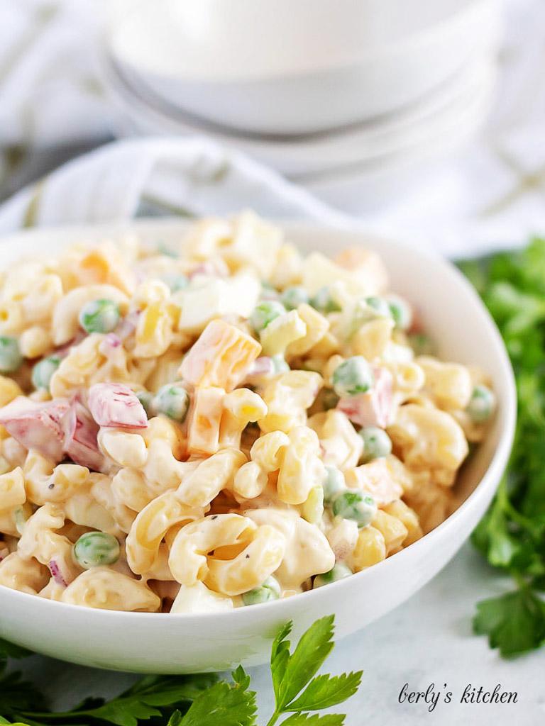Large white bowl filled with macaroni salad.