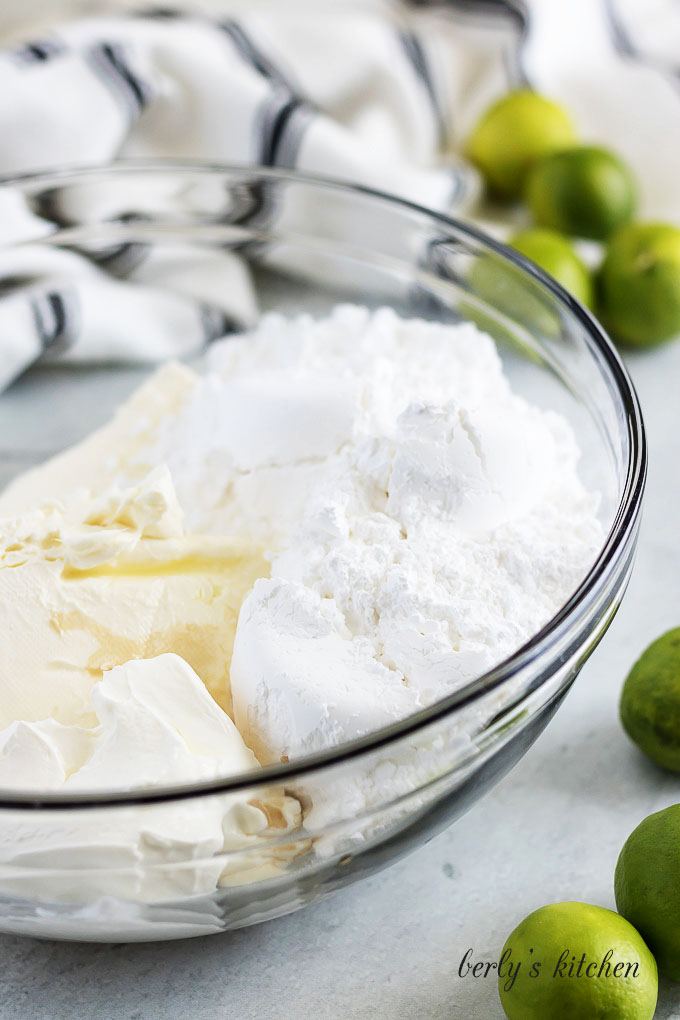Powdered sugar, cream cheese, and key lime juice in a mixing bowl.
