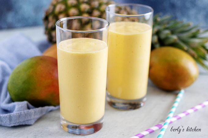 Glasses of mango smoothie with fresh pineapple.