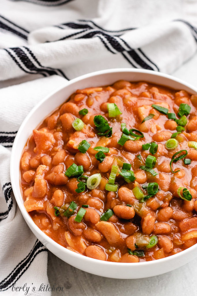 Top down view of baked beans in a dish.