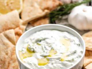 Bowl of tzatziki sauce drizzled with olive oil.