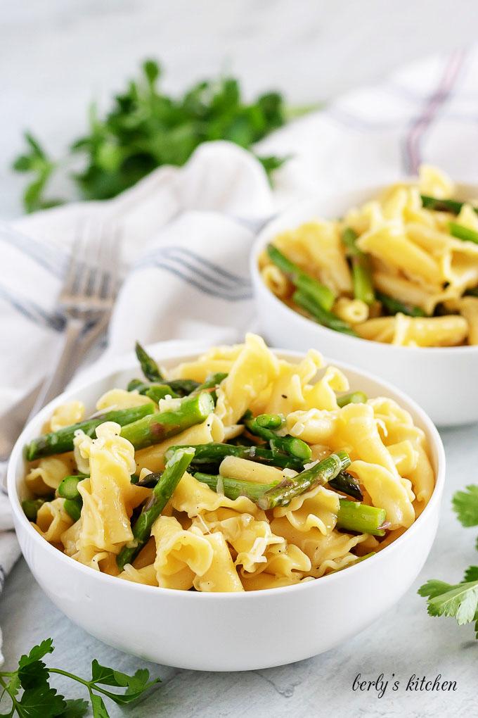 Two bowls of garlic asparagus pasta.