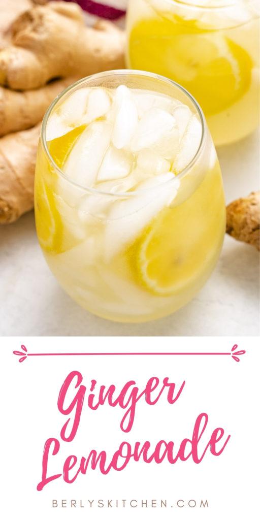 Ginger lemonade in a glass next to fresh ginger.