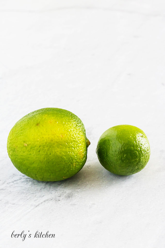 Photograph showing the difference between limes and key limes.